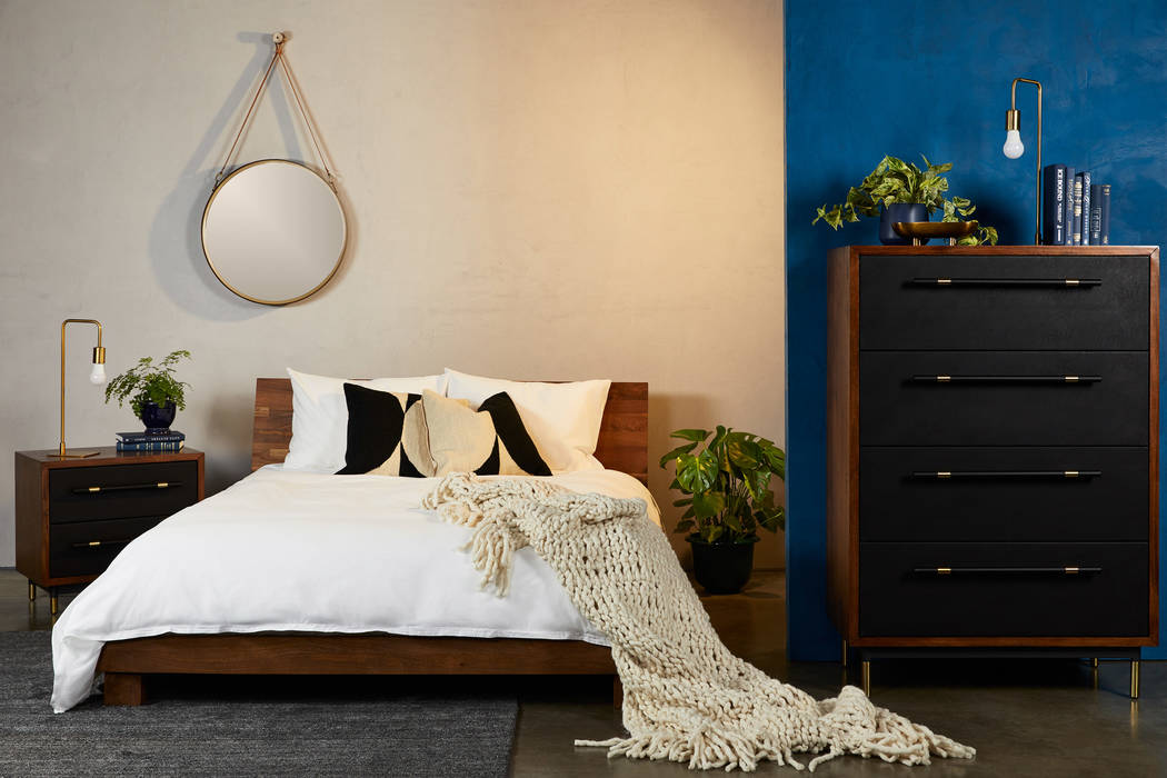 With distinct stylings, Fernish's Roxbury bedroom features black faux leather accents on the dr ...
