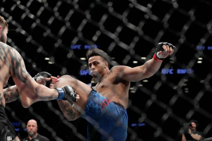 Greg Hardy kicks Allen Crowder during the first round of a heavyweight mixed martial arts bout ...