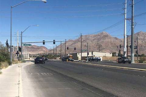 Police respond to a multi-vehicle crash at Nellis Boulevard and Carey Avenue in Las Vegas on Fr ...