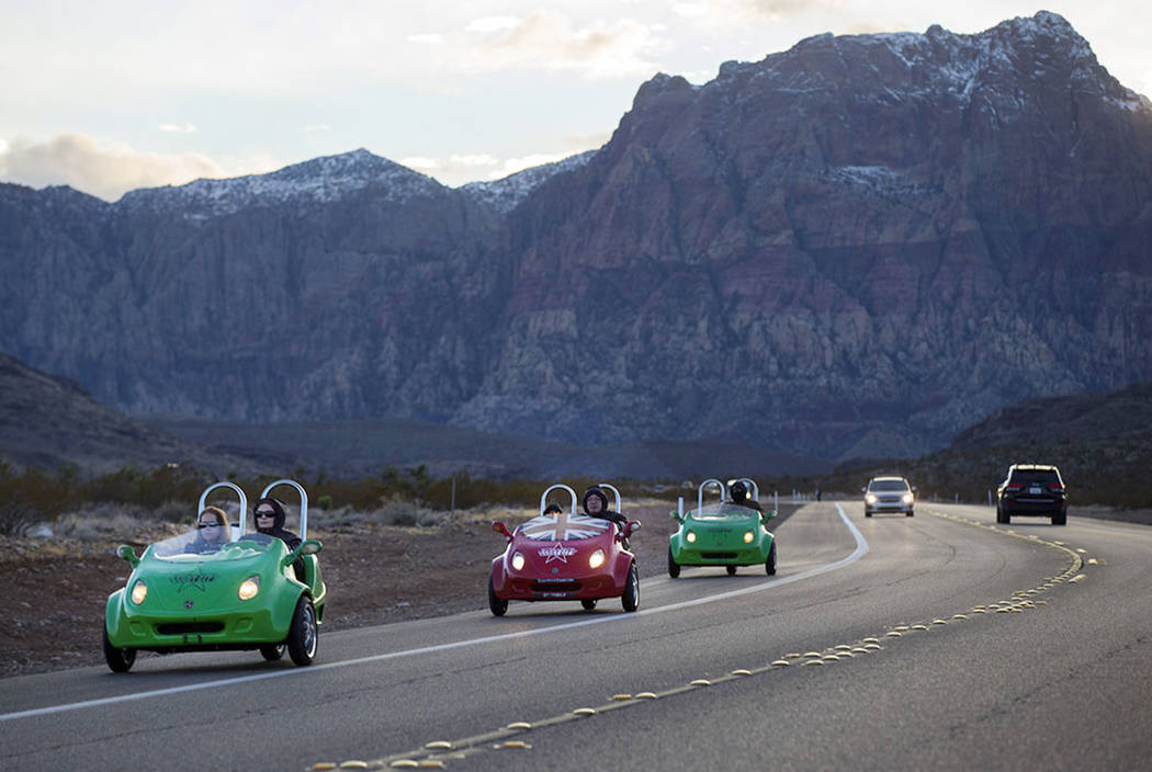 Scooter cars pass through the Red Rock Canyon National Conservation Area outside of Las Vegas o ...