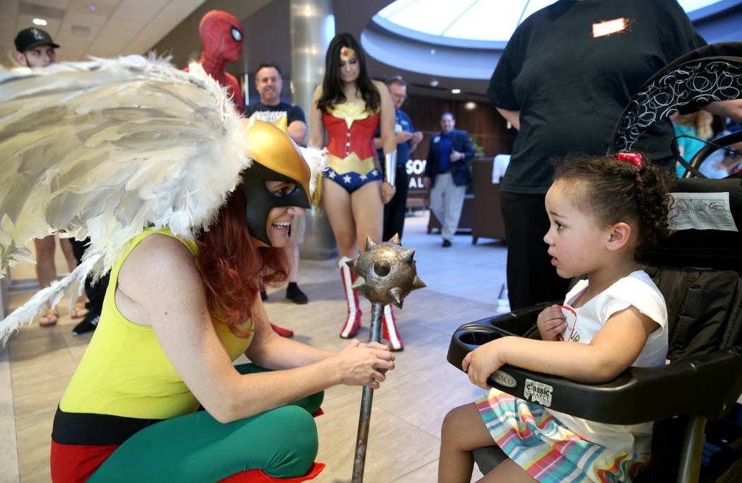 Marry Ann Nocie as Hawkgirl greets JernieLynn Montgomery, 3, during the first-ever Neonatal Int ...