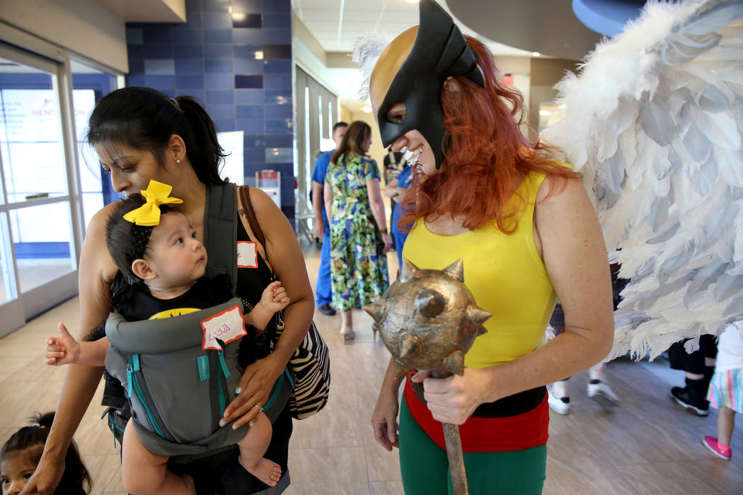 Marry Ann Nocie as Hawkgirl greets Luna Rivas, 3 months, and her mother Evie Rivas during the f ...