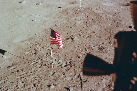 This July 21, 1969 photo made available by NASA shows Tranquility Base and the U.S. flag from a ...