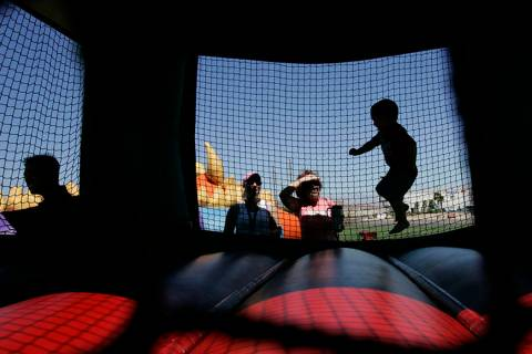 Kids play inside a bounce house. (Las Vegas Review-Journal)