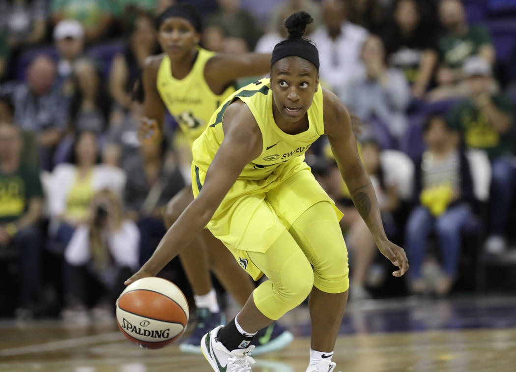 Seattle Storm's Jewell Loyd brings the ball up against the Las Vegas Aces during the first half ...