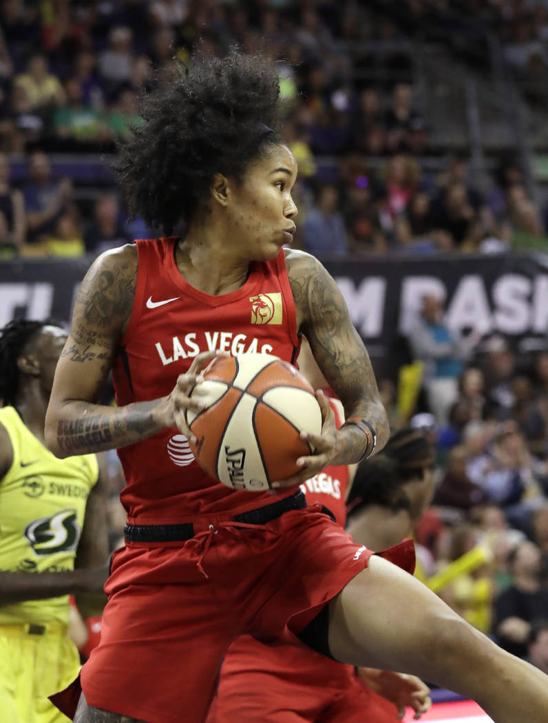 Las Vegas Aces' Tamera Young grabs a rebound against the Seattle Storm during the first half of ...