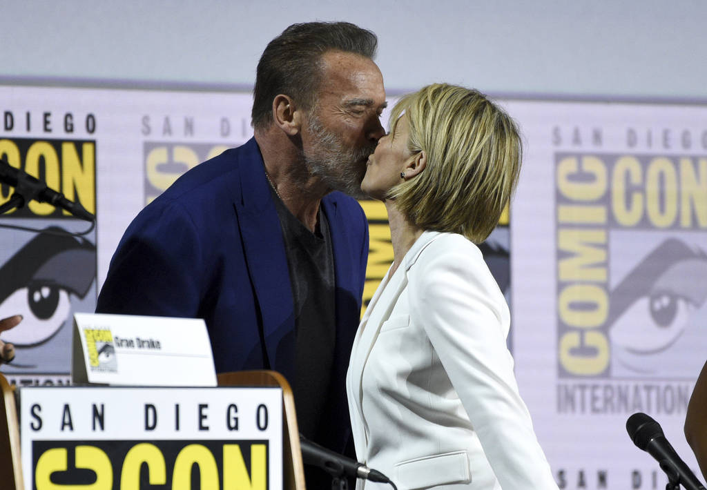 "Arnold Schwarzenegger, left, and Linda Hamilton kiss at the ""Terminator: Dark Fate"" p ..."