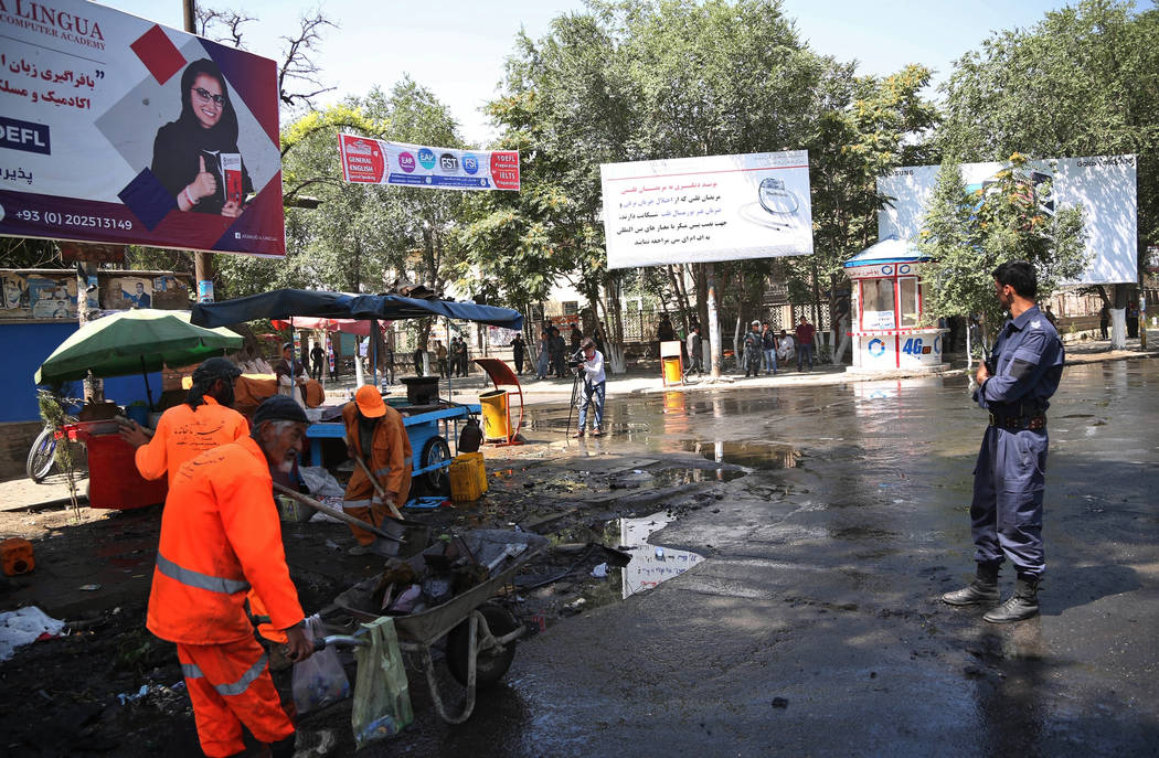 Afghan security forces stand guard near the site of an explosion in Kabul, Afghanistan, Friday, ...