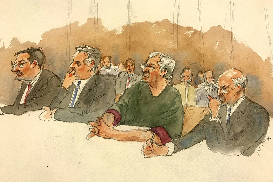 In this courtroom sketch, defendant Jeffrey Epstein, second from right, listens along with defe ...