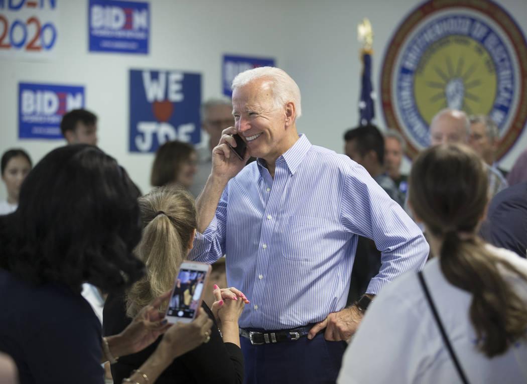Democratic presidential candidate former Vice President Joe Biden, middle, makes phone calls du ...