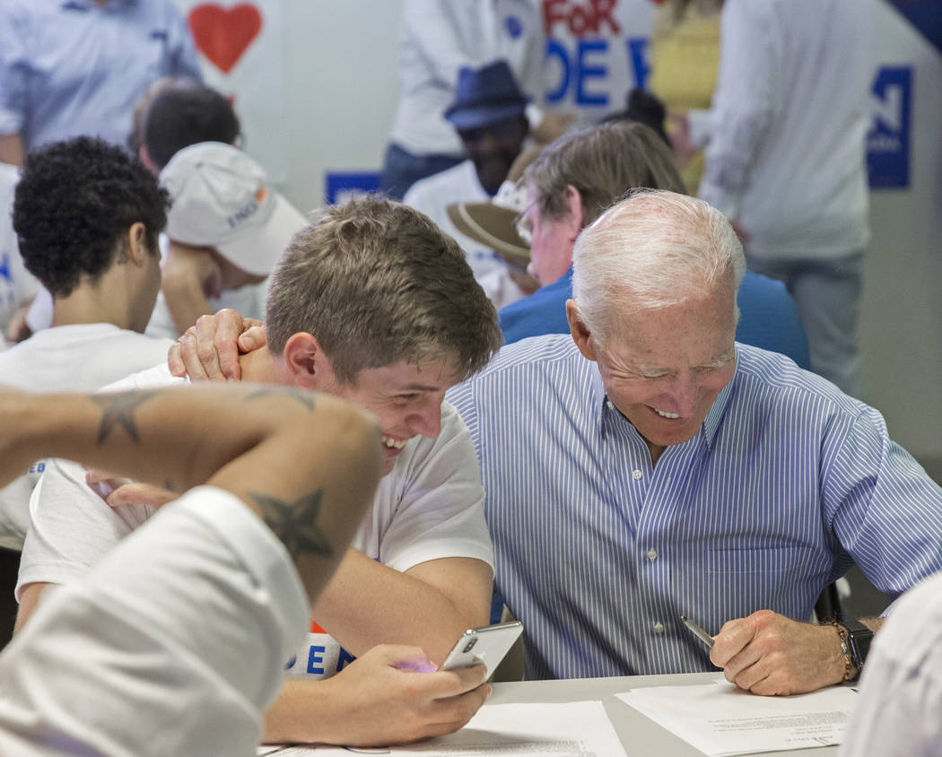 Democratic presidential candidate former Vice President Joe Biden, right, shares a laugh with A ...