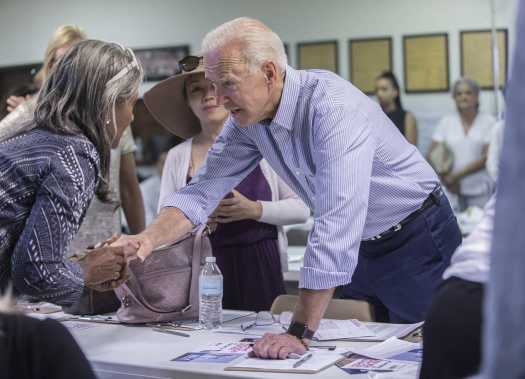 Democratic presidential candidate former Vice President Joe Biden, right, greets volunteer Cynt ...