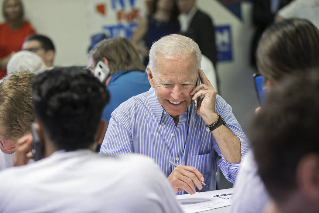Democratic presidential candidate former Vice President Joe Biden makes phone calls during the ...