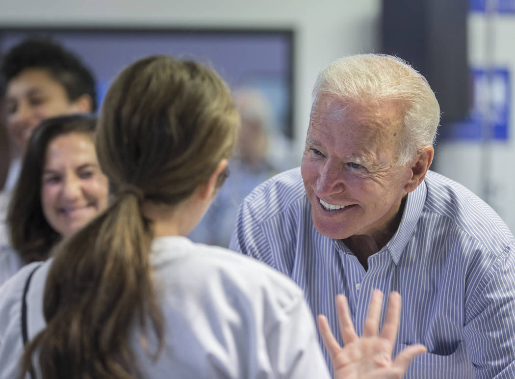 Democratic presidential candidate former Vice President Joe Biden, right, greets volunteers dur ...