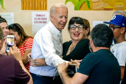 Democratic presidential candidate and former Vice President Joe Biden gets a hug from Felicia M ...