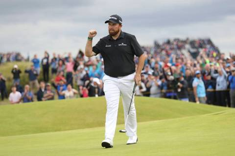 Ireland's Shane Lowry celebrates after making a birdie on the 15th green during the third round ...