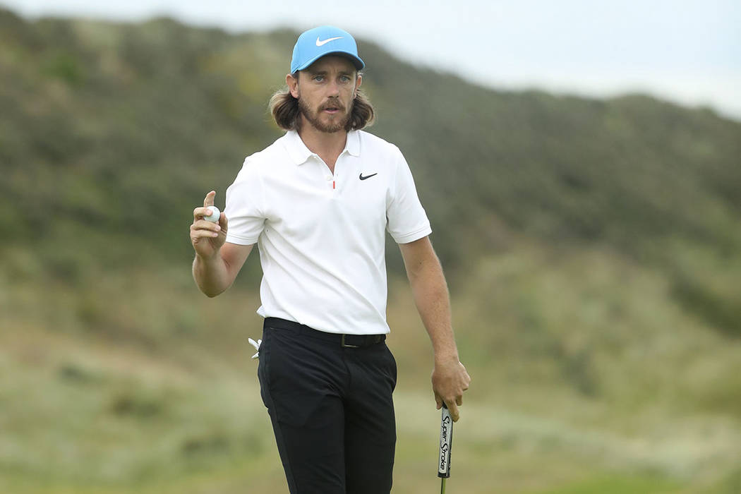 England's Tommy Fleetwood reacts after he saves parr on the 15th green during the third round o ...