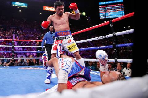 Manny Pacquiao reacts after knocking down Keith Thurman in the first round during a welterweigh ...