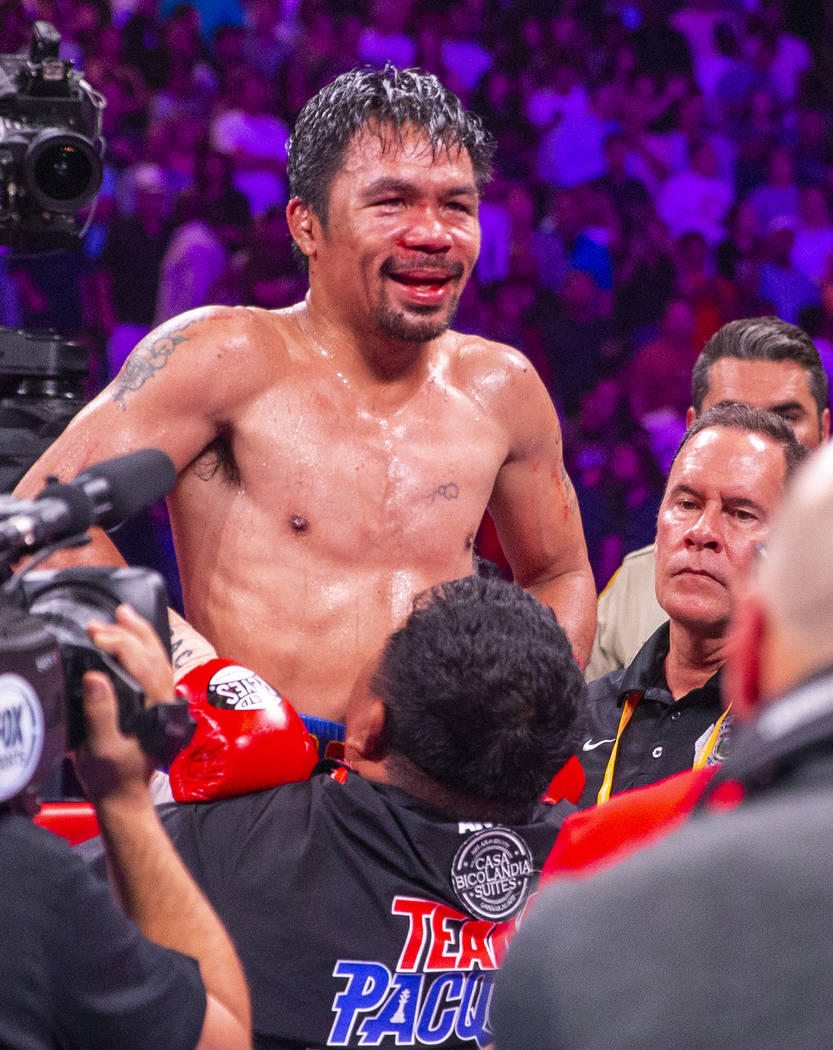 Manny Pacquiao is lifted in celebration after defeating Keith Thurman in their WBA super welter ...