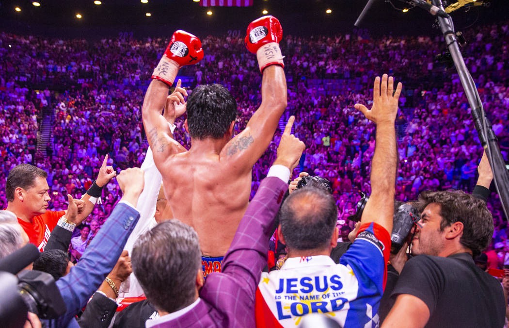 Manny Pacquiao celebrates with the crowd after defeating Keith Thurman in their WBA super welte ...