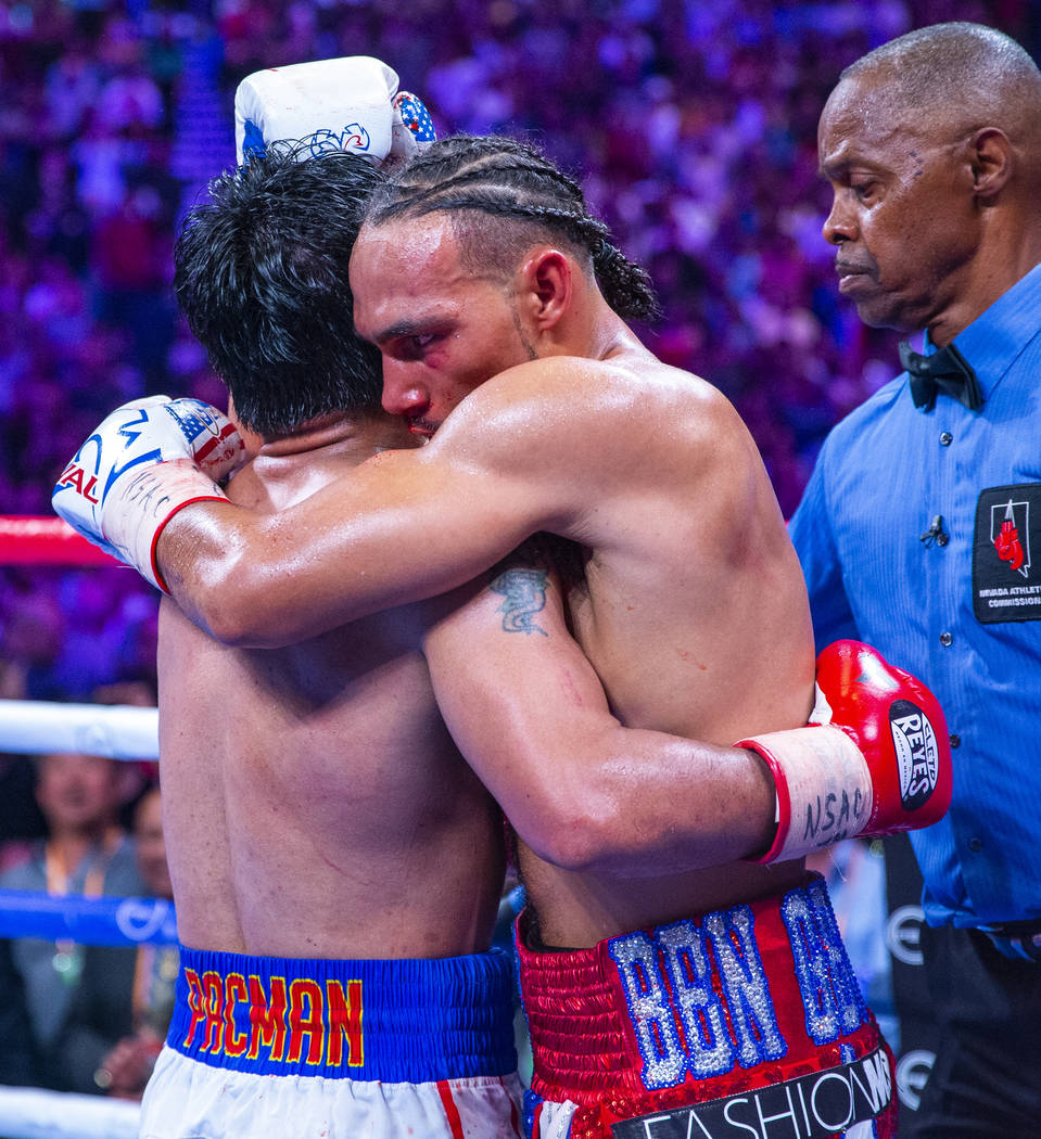Manny Pacquiao, left, and Keith Thurman embrace in the ring following their WBA super welterwei ...