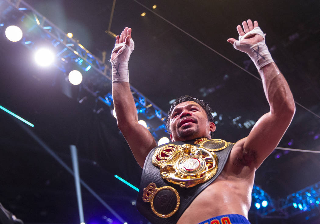 Manny Pacquiao greets and thanks the fans after defeating Keith Thurman in their WBA super welt ...