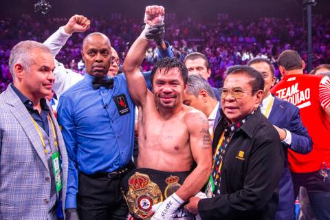 Manny Pacquiao with his belt after defeating Keith Thurman in their WBA super welterweight worl ...