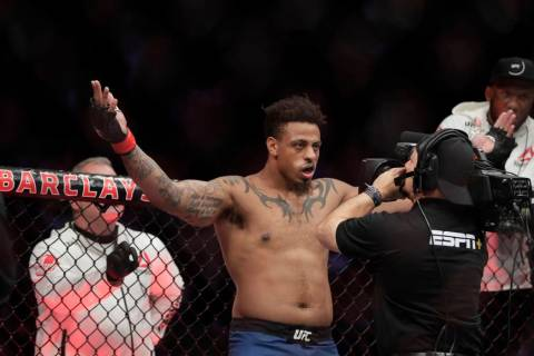Greg Hardy reacts as he is announced for a heavyweight mixed martial arts bout against Allen Cr ...