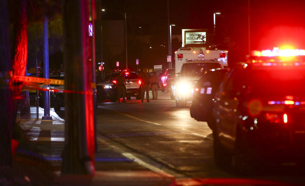 Las Vegas police gather outside of University Medical Center in Las Vegas on Saturday, July 20, ...