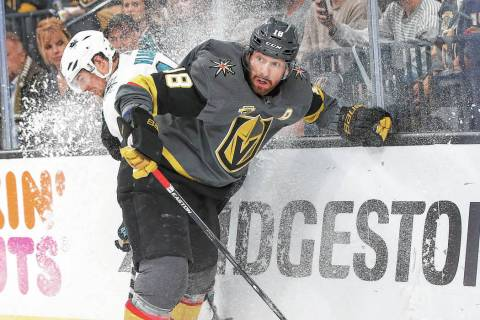 Golden Knights left wing James Neal (18) battles for the puck against San Jose Sharks defensema ...