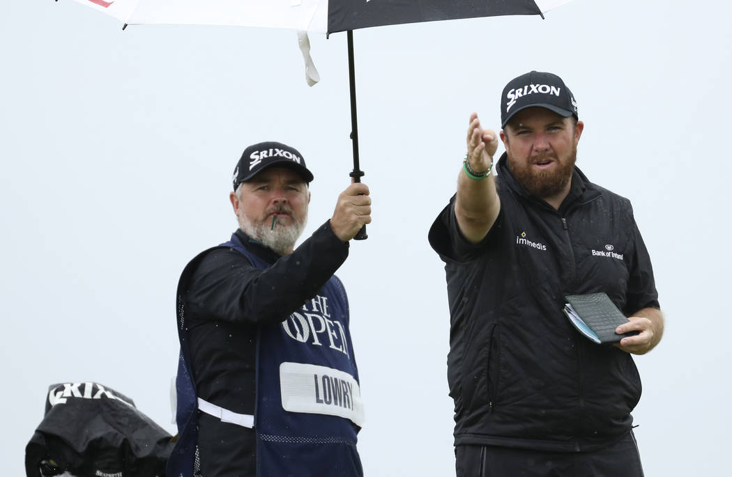 Ireland's Shane Lowry gestures as he looks dome the 6th hole from the tee during the final roun ...