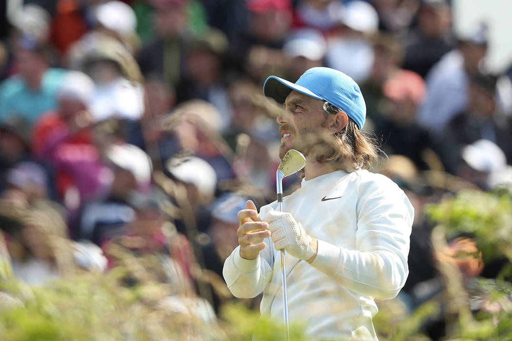 England's Tommy Fleetwood reacts to his shot from the 2nd tee during the third round of the Bri ...