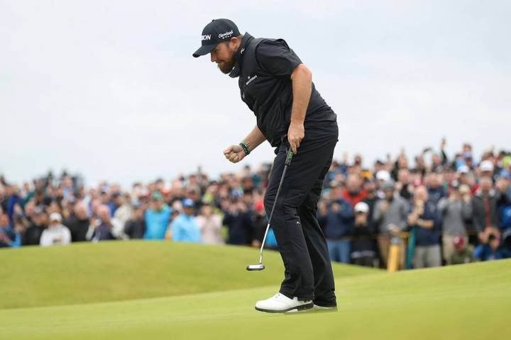 Ireland's Shane Lowry reacts after making a birdie on the 15th green during the final round of ...