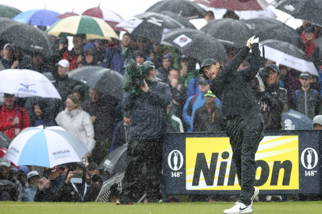 England's Tommy Fleetwood tees off the 9th tee hole in heavy rain during the final round of the ...