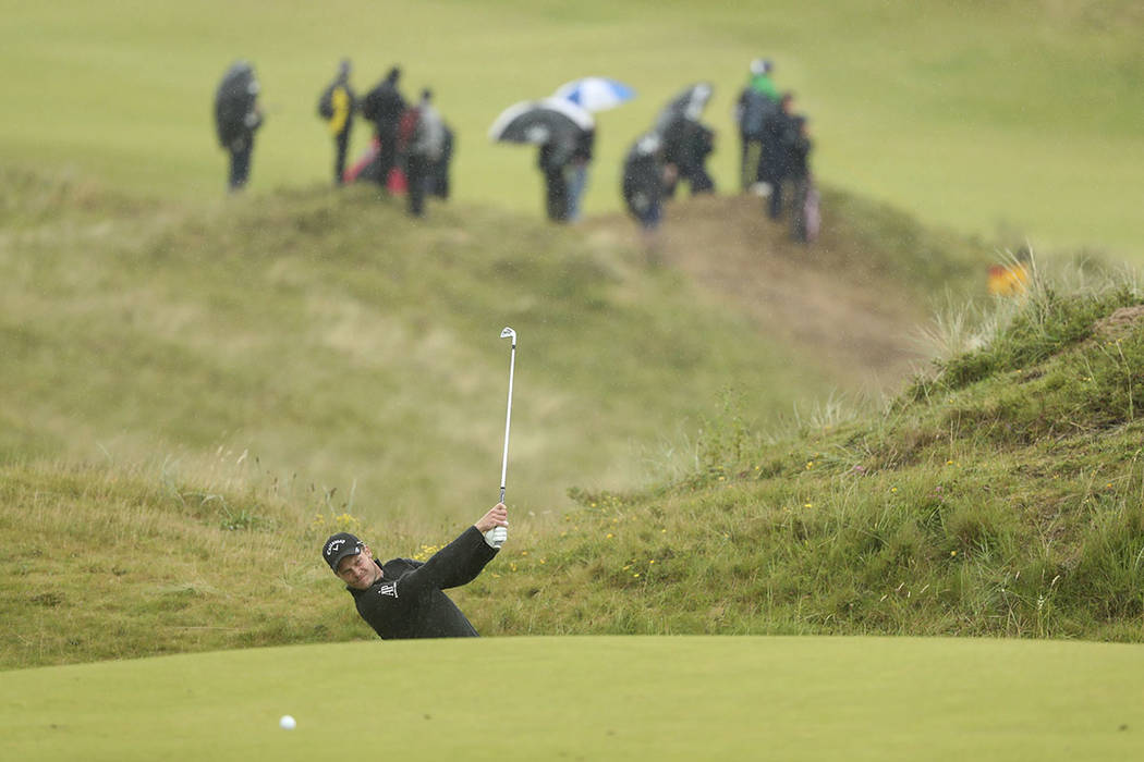 England's Danny Willett plays to the 8th green during the final round of the British Open Golf ...