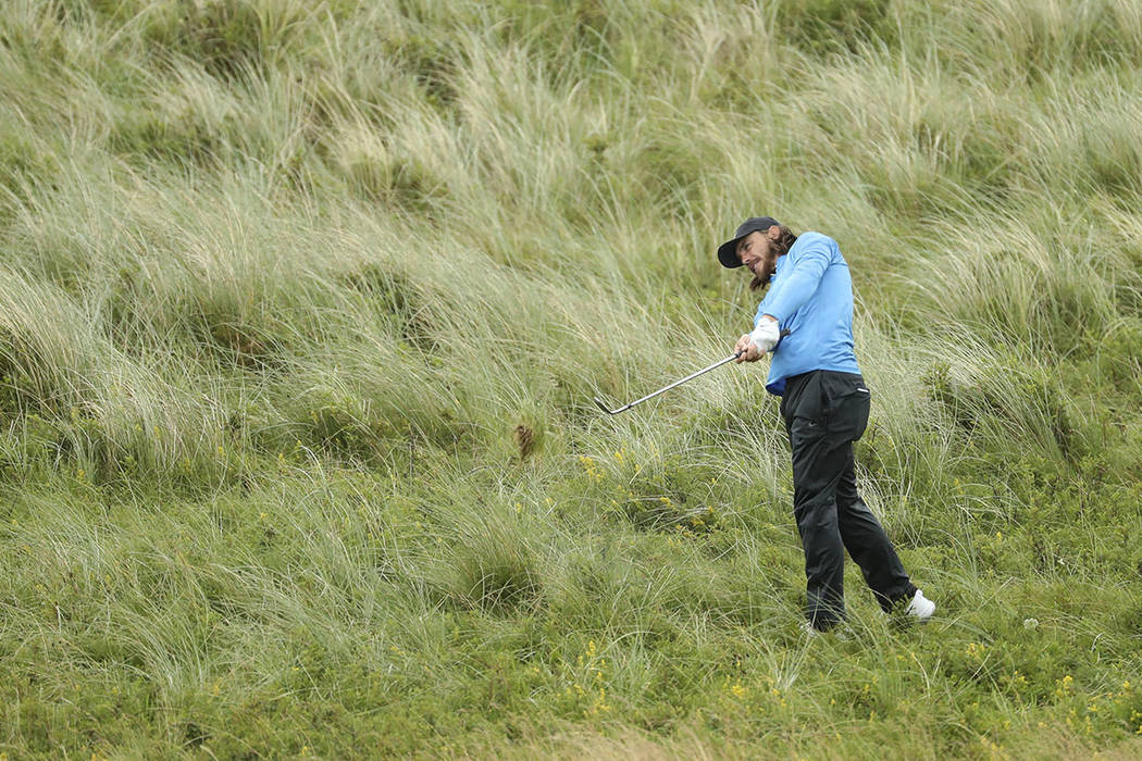England's Tommy Fleetwood plays from the rough on the 7th hole during the final round of the Br ...