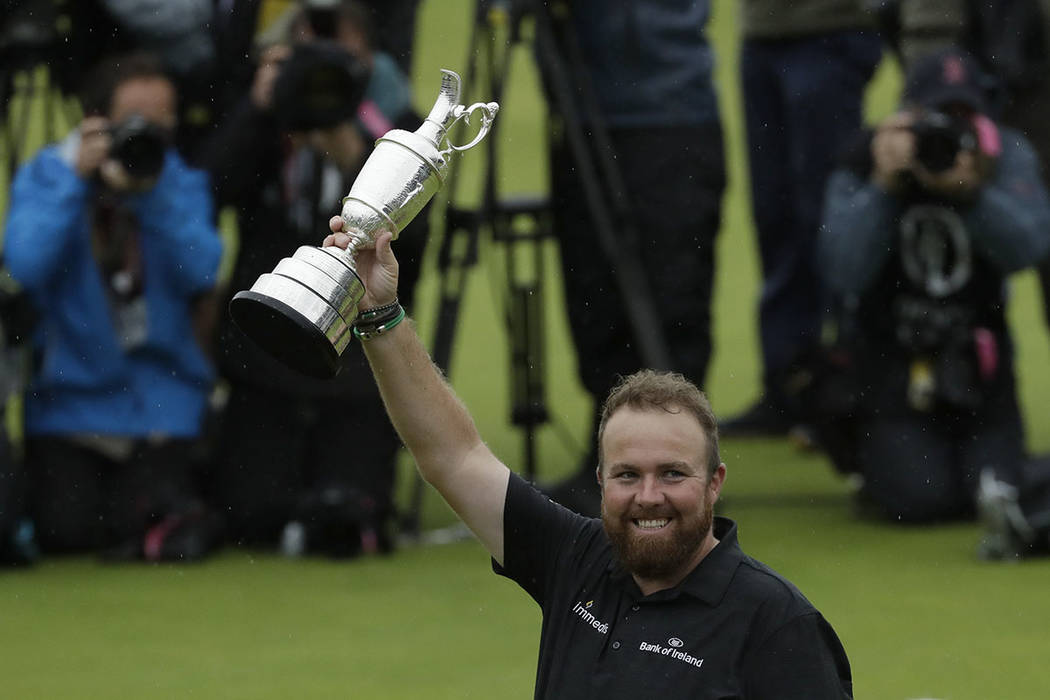 Ireland's Shane Lowry holds up the Claret Jug trophy after winning the British Open Golf Champi ...