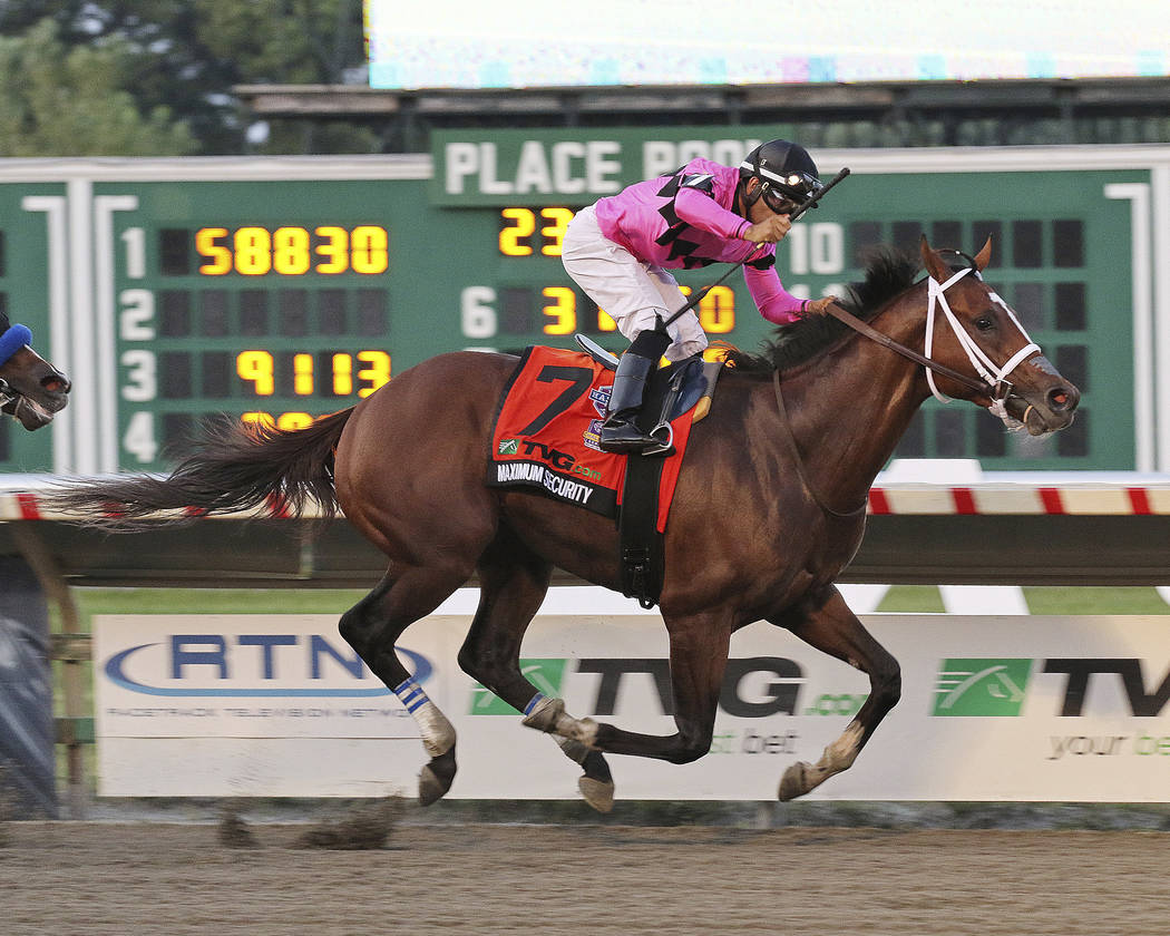 In this image provided by Ryan Denver/EQUI-PHOTO, Inc., Maximum Security (7), ridden by Luis Sa ...
