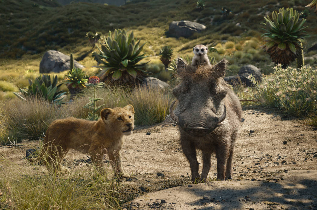 FILE - This file image released by Disney shows, from left, young Simba, voiced by JD McCrary, ...