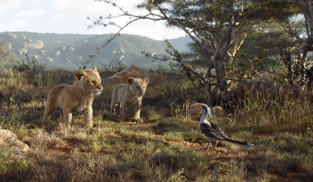 This image released by Disney shows, from left, young Simba, voiced by JD McCrary, young Nala, ...