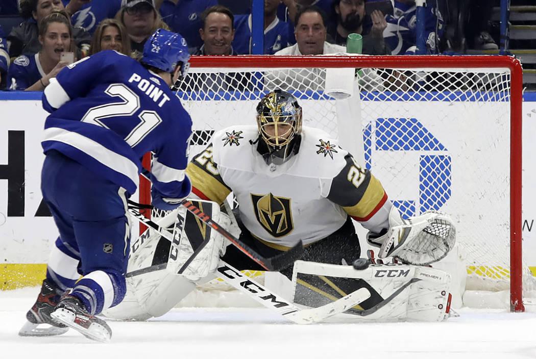 Vegas Golden Knights goaltender Marc-Andre Fleury (29) stops a shot by Tampa Bay Lightning cent ...