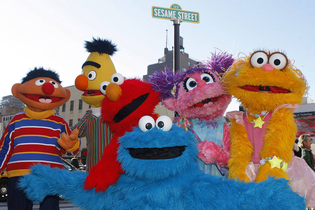 FILE - In this Feb. 10, 2010 file photo, characters from Sesame Street Live appear on the stree ...