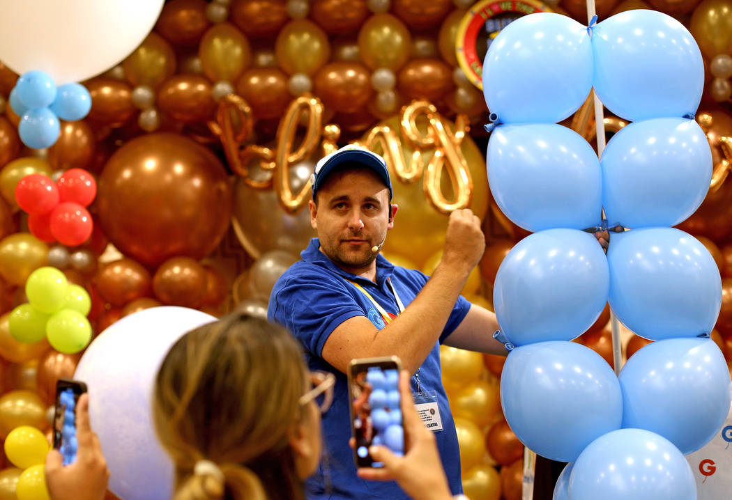 Gergo Lufis Vilaga, a balloon artist from Hungary, leads a workshop on how to make a balloon ba ...