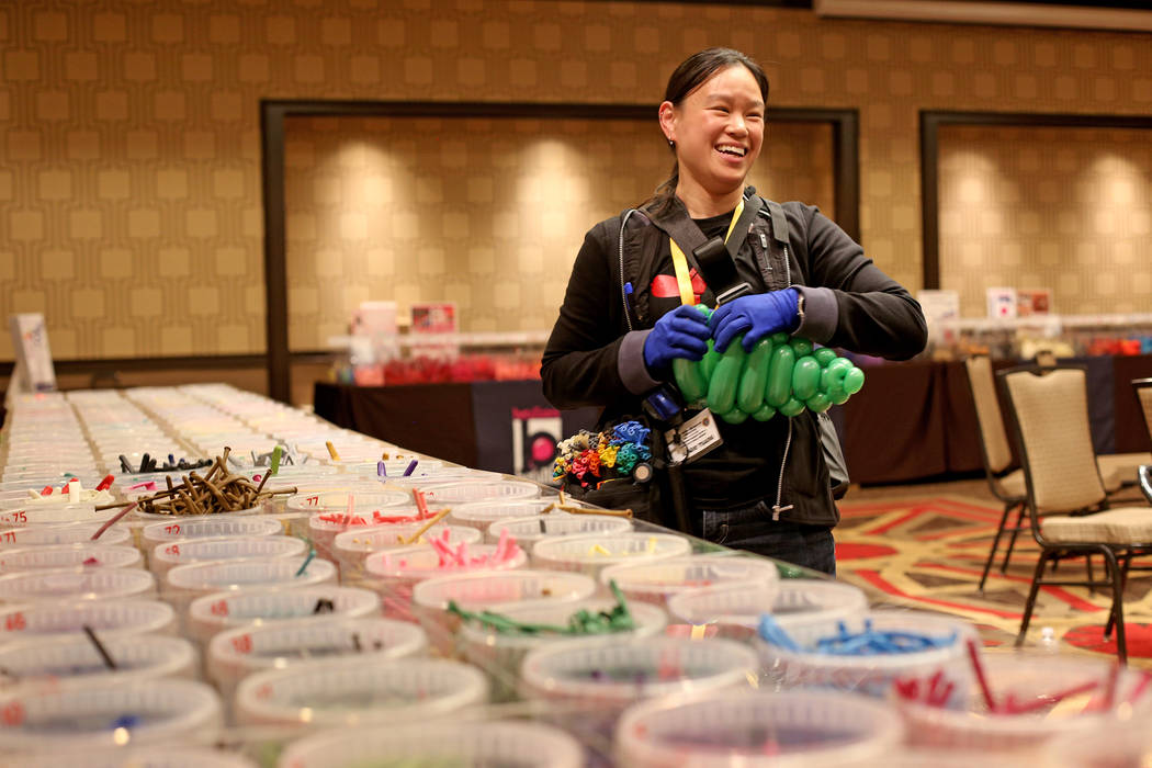 Angie Tsang of California plays with balloon twisting at the Bling Bling Balloon Jam convention ...