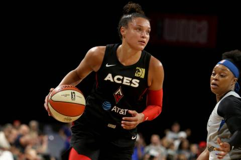 Las Vegas Aces guard Kayla McBride (21) dribbles to the hoop against Minnesota Lynx guard Odyss ...