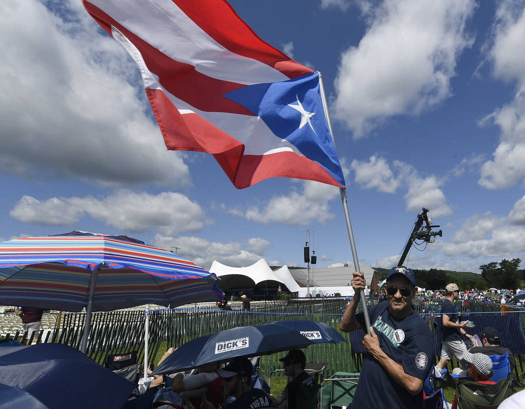 Miguel Rosario of Atlantic City, N.J., waves a Puerto Rican Flag while waiting for the start of ...