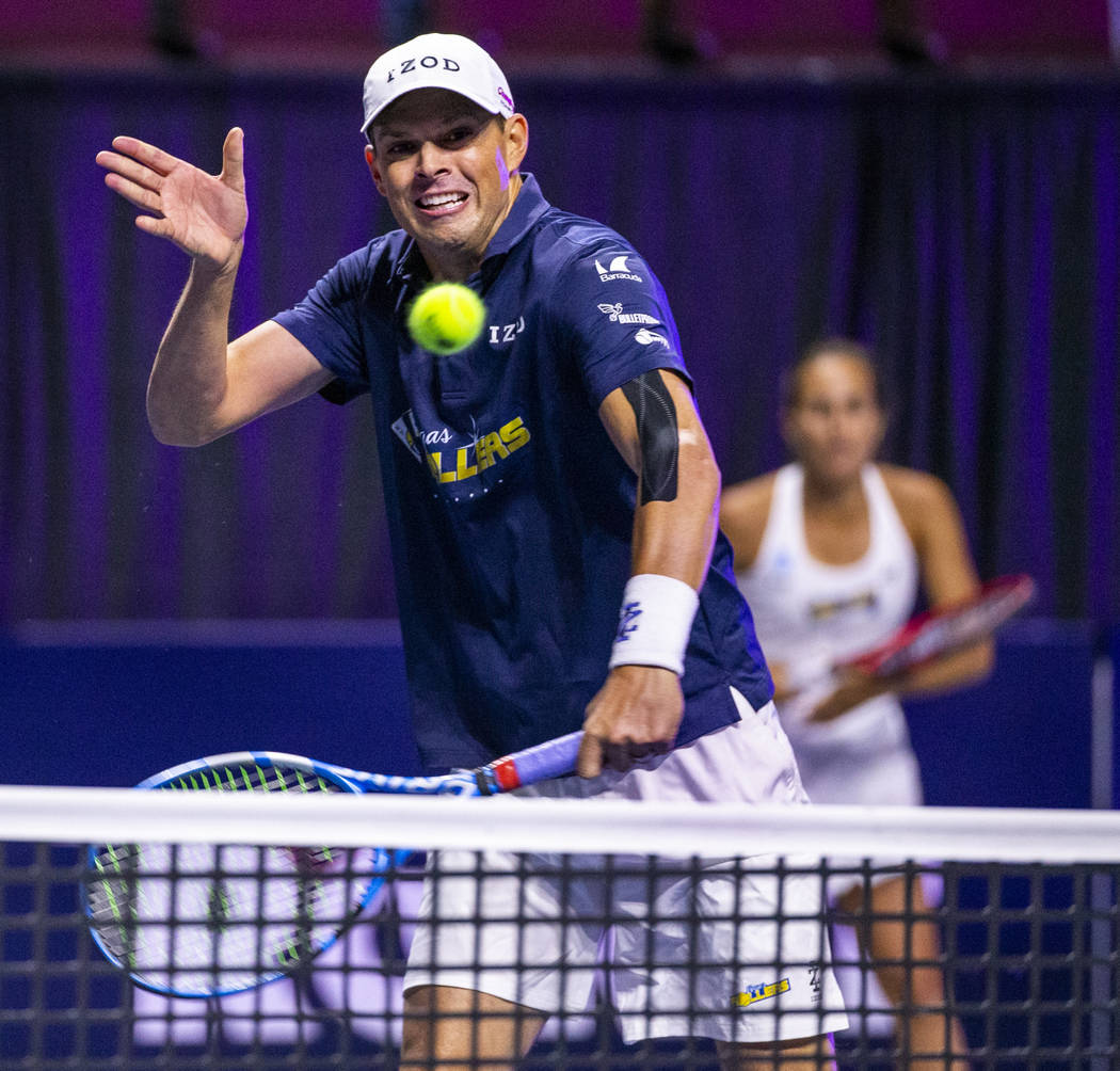 The Vegas Rollers' Bob Bryan returns a ball over the net in front of mixed doubles parter Monic ...