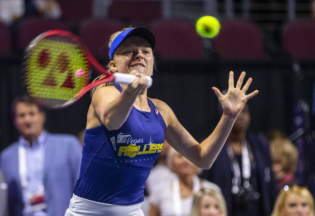 The Vegas Rollers' Harriet Dart returns a ball over the net during her mixed doubles set versus ...