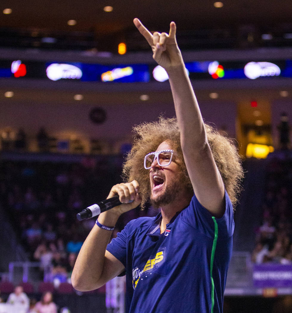 The Vegas Rollers' assistant coach Stefan Redfoo Gordy pumps up the crowd versus the Philadelph ...