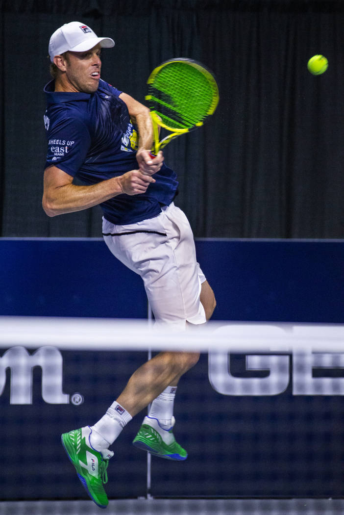 Vegas Rollers' Sam Querrey sends a backhand over the net as he closes the gap in score during h ...